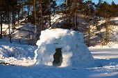 stock photo of igloo  - igloo constructed by the hands for spending the night - JPG