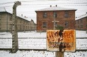 stock photo of deportation  - High voltage sign at a german WWII prisoner camp - JPG