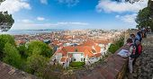 LISBON, PORTUGAL - APRIL 18, 2014: tourists sightseeing in Sao Jorge Castle with a view over the cit
