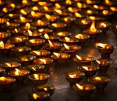 picture of himachal pradesh  - Burning candles in Buddhist temple - JPG