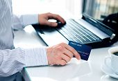pic of payment methods  - Businessman making a card payment on the internet - JPG