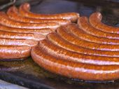 Budapest, Hungary, Fair. Hungarian sausages fried in a pan in the outdoor cafes