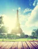 Eiffel tower in Paris and wooden surface