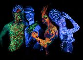 Body art glowing in ultraviolet light