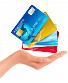 Hand holding credit cards. Raster version