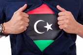 Young Sport Fan Opening His Shirt And Showing The Flag His Country Libya, Libyan Flag