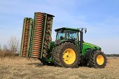 John Deere 8430 Agricultural Tractor With Ring Roller By Field