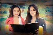 Young Women Choosing from a Restaurant Menu