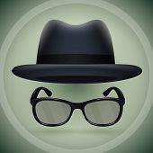 Black fedora and eyeglasses.