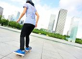 young woman skateboarder skateboarding at  modern citywoman skateboarder skateboarding at city