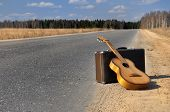 Baggage And Guitar On Empty Road