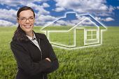Smiling Woman in Grass Field with Ghosted House Figure Behind.