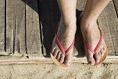 Women Foots On The Beach