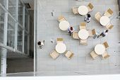 pic of canteen  - High angle view of businesswomen walking at office canteen - JPG