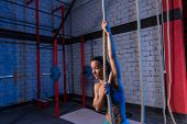 Climb rope exercise woman workout at gym