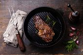 Grilled Ribeye Steak Entrecote On Grill Pan On Wooden Background