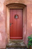 Narrow red brown wooden door