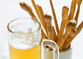 Mug Of Beer And Bread Sticks Close Up