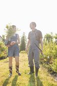 Gardeners conversing at plant nursery