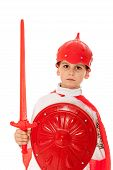 image of valiant  - Young Boy Dressed Like a knight holding a sword and shield isolated on white - JPG