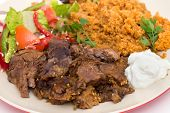 roast lamb kuzu tandir, served with bulgur pilaf and a tossed Turkish salad, all mainstays of Ottoman cuisine