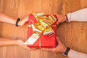 hands giving christmas box