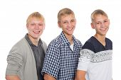 Three friends - two twin brothers and their friend the same age.