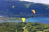 stock photo of annecy  - paragliders flying over Lake Annecy in France