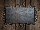 Old metal plate or sign on wooden door