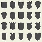Set of blank empty dark shields. Shield badge shapes icon