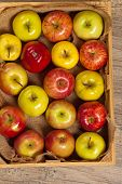 Fresh organic apples in wooden crate