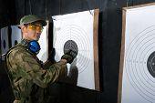 Man with target in shooting range