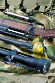 Different types of rifle guns on colorful background