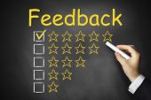 Hand Writing Feedback On Black Chalkboard Golden Rating Stars