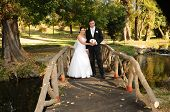 Young bride and groom couple posing outdoors
