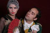 Men and girl in mascarade dresses