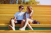 Sunny Portrait Young Couple In Love Summer, Stylish Teenagers Rest In Bench City Park