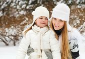 Young Blond Mother With Her Little Daughter Outdoors