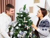 Young Happy Couple By The Cristmas Tree