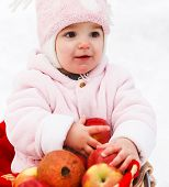 Happy Baby With Apples In Winter Park