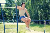 Street Workout, Handsome Sporty Guy On Horizontal Bars