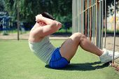 Workout, Fitness, Sport - Concept. Sportsman Doing Abdominal Exercises