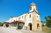 Scenic view of an ancient church in the touristic village of Lastres Asturias Spain.