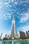 Burj Khalifa Vanishing In Blue Sky In Dubai, Uae.