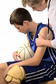 doctor giving first aid the hurt sportsman