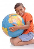 Child  holding  a globe  on the  white background