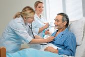 doctor examining a senior patient in hospital