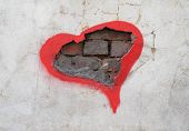 Texture Of Wall With Hole In Which The Bricks Are Visible, Encircled In Red Ink In Form Of Heart