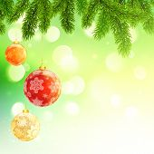 Christmas template with hanging balls fir tree branches on green bokeh background