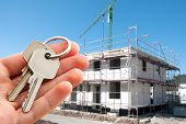 Real estate agent offer keys to new home